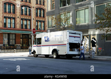 A truck from the US Postal Service making a mail delivery in Tribeca, a neighborhood in Lower Manhattan, New York - Stock Photo