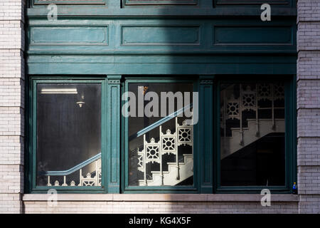 Detail of building window and stairway on 18th street near sixth avenue in New York City. - Stock Photo