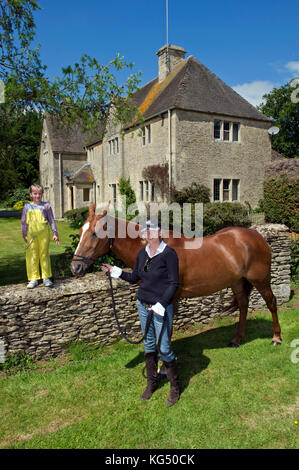 Kelly Luchford and daughter Lola (7) at her house in Gloucestershire. - Stock Photo