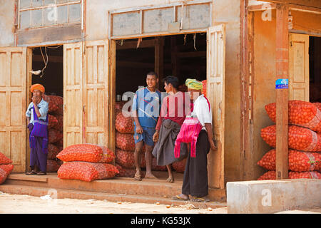 Burmese men of the Pa'O / Pao tribe in front of warehouse at the town Aungban, Kalaw Township, Taunggyi District, - Stock Photo