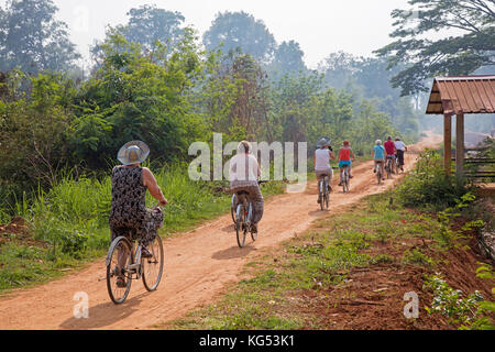Western tourists cycling on bicycles near the Inle lake in the Nyaungshwe Township of Taunggyi District, Shan State, - Stock Photo