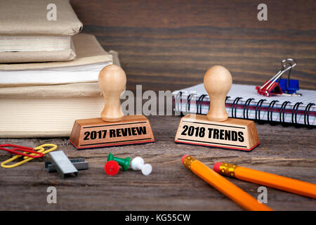 2017 review and 2018 trends. Rubber Stamp on desk in the Office. Business and work background - Stock Photo