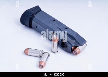 Handgun magazine with hollow point bullets, for a .40 caliber weapon. - Stock Photo