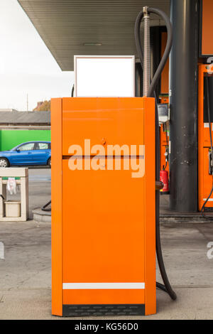 Orange Gas Station vacuum cleaner unit, with small announcement board mock up - Stock Photo