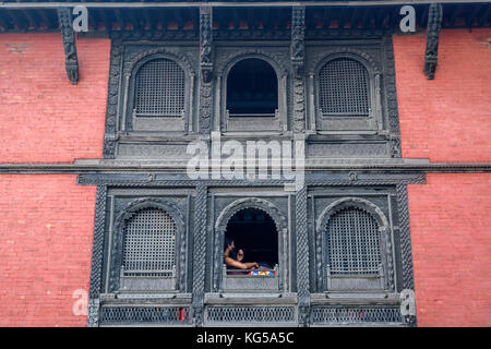 Wall of  an Ancient Hindu temple with intricate artwork and carvings at Varanasi ghat. Selective focus is used. - Stock Photo