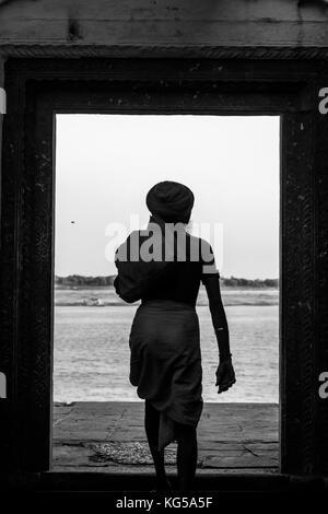 Monochrome backside of a sadhu baba at Varanasi,India. - Stock Photo