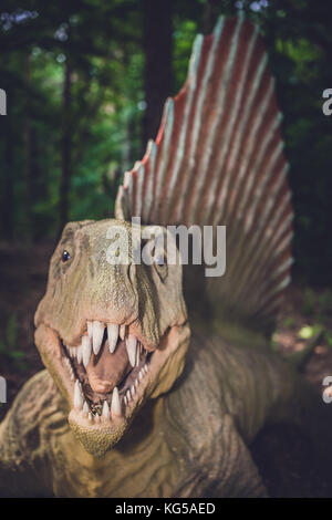 Solec Kujawski, Poland -  August 2017 :  Life sized spinosaurus dinosaur statue in a forest - Stock Photo