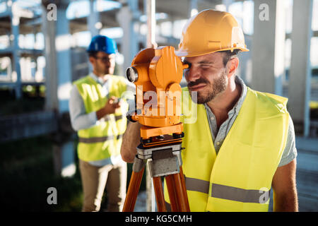 Picture of construction engineer working on building site - Stock Photo