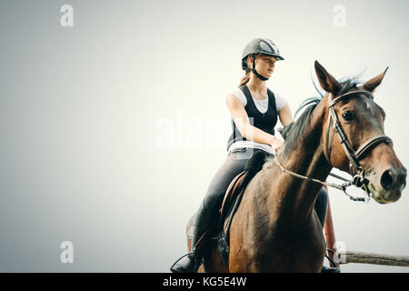 Picture of young girl riding her horse - Stock Photo