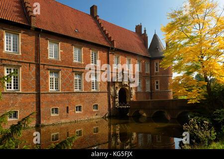 Herten Castle (moated castle) in autumn, Herten, North Rhine-Westphalia, Germany - Stock Photo
