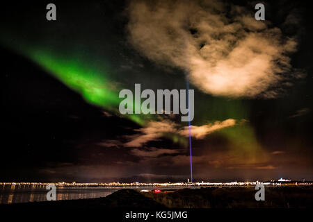 Aurora Borealis or Northern Lights with the Imagine Peace Tower, Reykjavik, Iceland - Stock Photo