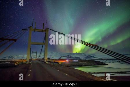 Aurora Borealis. Bridge (Jokulsabru) over Blautbalakvisl river, Breidamerkursandur by Jokulsarlon, Iceland - Stock Photo