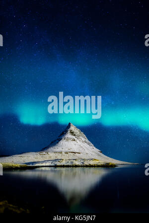 Aurora borealis with Mt. Kirkjufell in Grundarfjordur on Snaefellsnes Peninsula, Iceland - Stock Photo