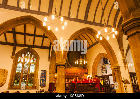 England, Oxfordshire, Oxford, St Michael at the North Gate Church, Choir Singing - Stock Photo