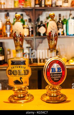 England, Cotswolds, Gloucestershire, Stow-on-the-Wold, Pub Beer Pump Handles - Stock Photo