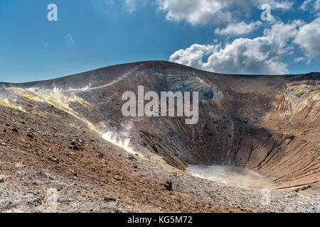 Volcano, Messina district, Sicily, Italy, Europe. Sulfur fumaroles on the crater rim of Vulcano. - Stock Photo