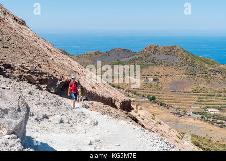 Volcano, Messina district, Sicily, Italy, Europe. Hiker in the ascent to the crater of the Vulcano - Stock Photo