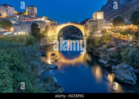 Old Bridge (Stari Most) and Neretva river at dusk, Mostar, Bosnia and Herzegovina - Stock Photo