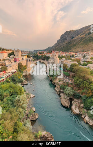 Elevated view of the Neretva river crossed by the Old Bridge (Stari Most) in Mostar old town, Federation of Bosnia - Stock Photo