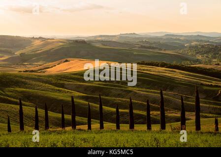 Hills of Crete Senesi at Sunset, Asciano, Siena Province, Tuscany region, Itlay, Europe. - Stock Photo