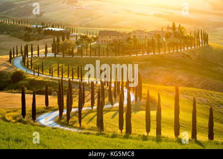 Baccoleno Farmhouse at Sunset, Asciano, Crete Senesi, Siena Province, Italy, Europe. - Stock Photo