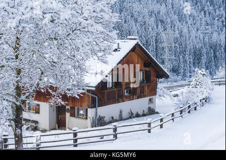 A house of the small town of Filisur with snow in winter. Switzerland, Europe - Stock Photo