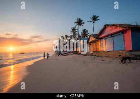 Bavaro Beach, Bavaro, Higuey, Punta Cana, Dominican Republic. Beach huts at sunrise. - Stock Photo