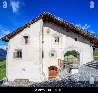 Panorama of typical alpine house framed by blue sky Guarda canton of Graubünden Inn District Lower Engadine Switzerland - Stock Photo