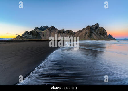 Stokksnes, Hofn, Eastern Iceland, Iceland. Vestrahorn mountain seen by the bay - Stock Photo