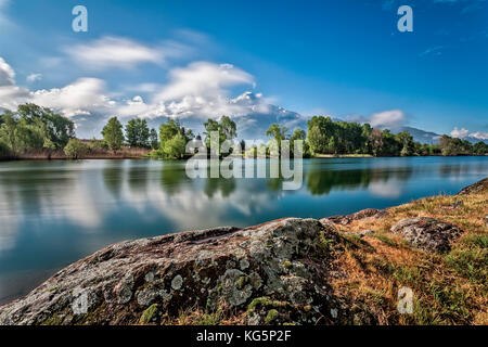 river Mera, Lake Como, Mountain, Legnone, trees, reflection, lombardy, italy Spring colouurs on Mera river from - Stock Photo