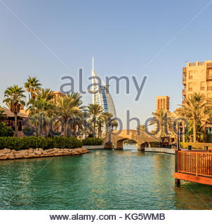 A view of Madinat Jumeirah and the famous Burj Al Arab luxurious hotel in Dubai. - Stock Photo