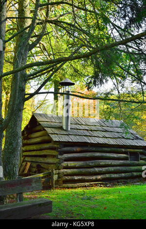 The blackmith's log cabin off the beaten path at historic Mabry Mill on the Blue Ridge Parkway in Virginia. - Stock Photo