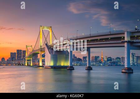 Tokyo. Cityscape image of Tokyo, Japan with Rainbow Bridge during sunset. - Stock Photo