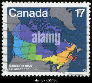 CANADA - CIRCA 1981: A stamp printed in Canada. Maps showing evolution of Canada from Confederation to present day - Stock Photo