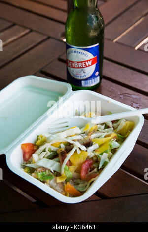 The Seychelles, Praslin, Baie St Anne, food smoked fish salad in biodegradable cardboard container - Stock Photo