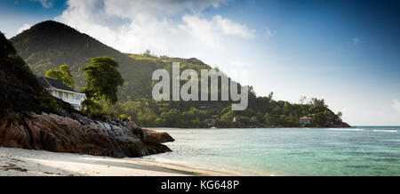 The Seychelles, Praslin, Petit Anse, seafront property on Grand Anse headland, panoramic - Stock Photo