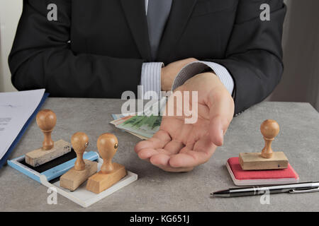 Pencil pusher asking for a bribe in euros or in dollars - Stock Photo