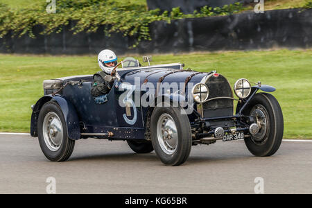 1930 Bugatti Type 50 with driver Mike Preston during the Brooklands Trophy race at the 2017 Goodwood Revival meeting, - Stock Photo