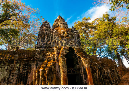 One of the gates adorned with stone faces, Angkor Tom (Angkor Wat complex), Cambodia. - Stock Photo