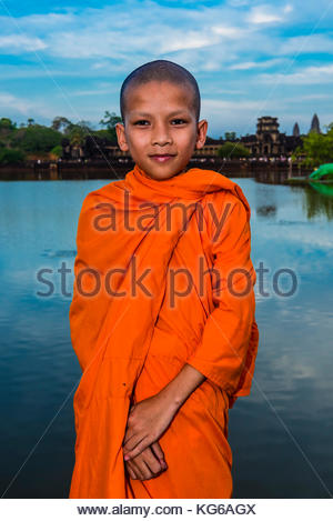 Novice  Buddhist monk, Angkor Wat, the largest religious monument in the world (means City which is a Temple); Cambodia. - Stock Photo