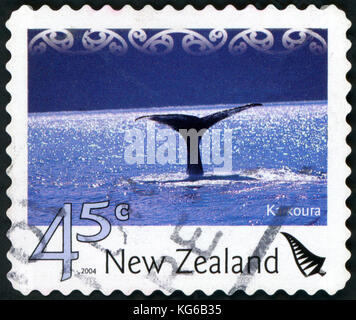 NEW ZEALAND - CIRCA 2004: a stamp from New Zealand shows image of a whale's tail, circa 2004 - Stock Photo