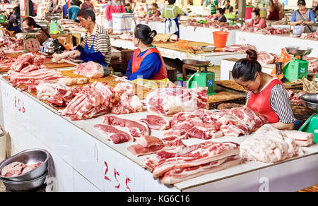 Lijiang, Yunnan, China - September 27, 2017: Fresh meat at the local market. China consumes around 28% of the world's - Stock Photo