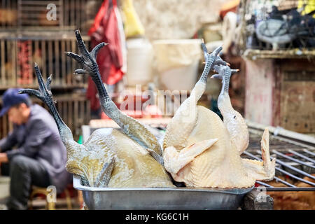 Lijiang, Yunnan, China - September 27, 2017: Close up picture of poultry on a tray at the local meat market. - Stock Photo
