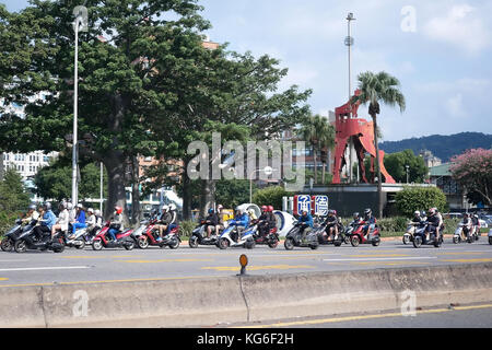 Taipei, Taiwan - October 28, 2017 : Motion of a lot of motorcycles riding on road in the morning. - Stock Photo