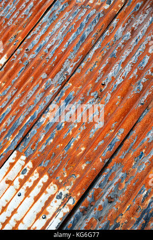Old Corrugated Tin Roof On Stone Farm Building With Snow