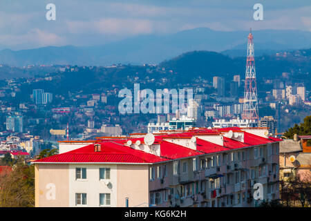 Aerial view of Sochi on the background of mountains in sunny day, Russia - Stock Photo