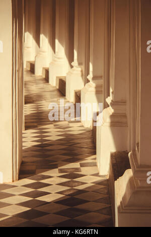 warm sunlight shines through a balcony house on the tile floor. abstract and art - Stock Photo