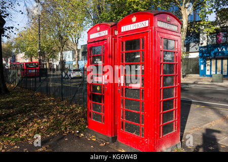 Two Pod Works micro office converted telephone kiosks, now disused and neglected, on Chiswick High Road, London, - Stock Photo