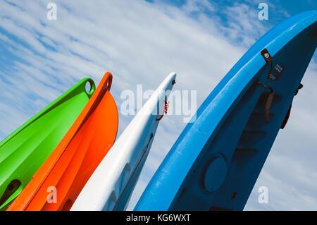 Sea Kayaks lined up on the beach - Stock Photo