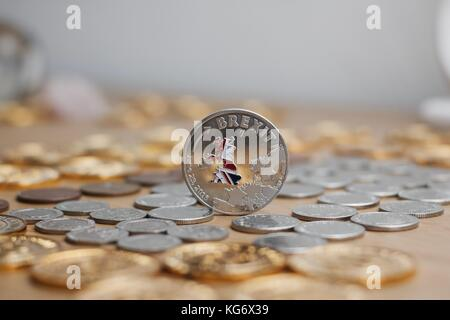 Physical metal silver brexit coin with British map on the front. Europe leaving. Article 50. - Stock Photo